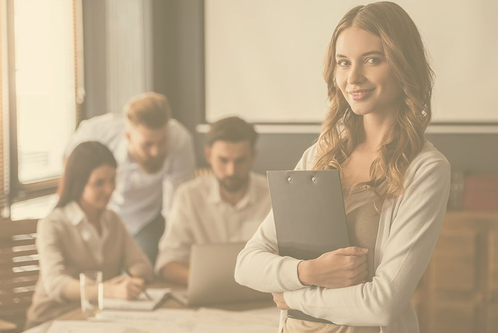 Substitute Decision Maker Services – young lady in focus with group of people in the back talking