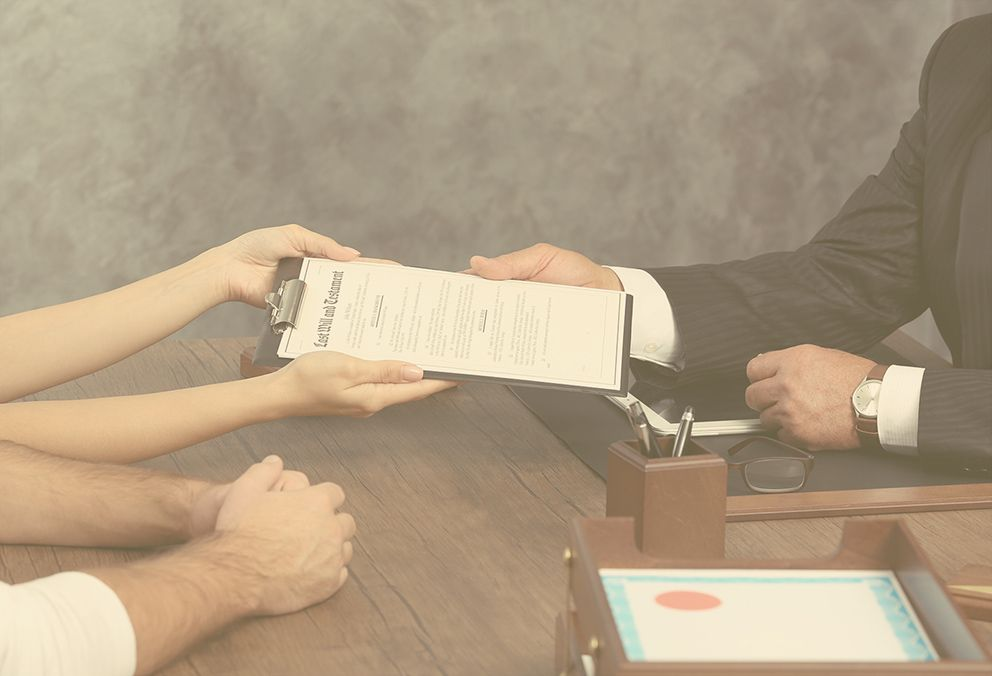 Trustee Services – judge holding form gave by a woman and man on the side