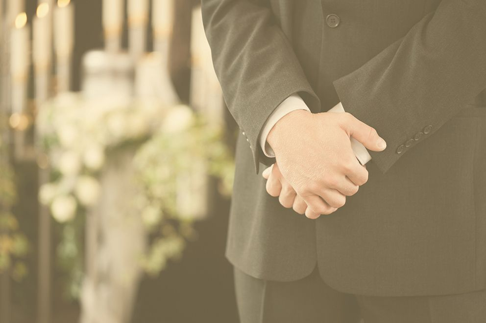 Executor Services – man holding his hands in a funeral